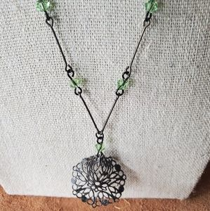 Dark chain with green crystals and pendant